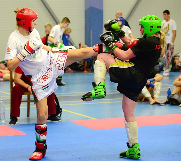 Slovakia against Austria, two kickboxing girls fight all geared of for the championship title in kick-light division